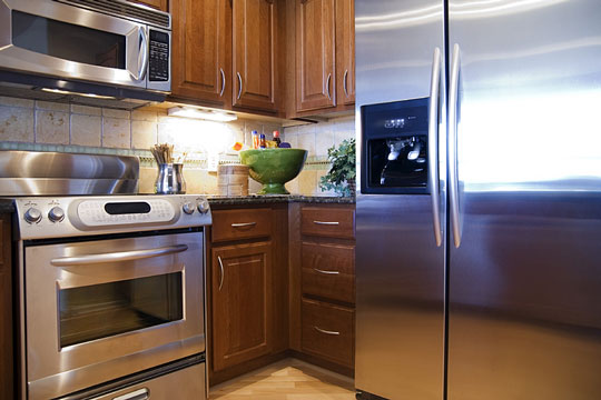 major appliances - refrigerator, stove, and microwave oven